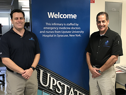 Chris C.  Knutsen, MD, MPH, left, and Stan Goettel, MS, EMT-P, are among the Upstate employees who work at the infirmary on the State Fairgrounds during the run of the fair, which ends Sept. 4.